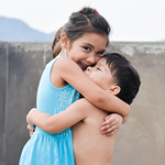 children smiling and hugging